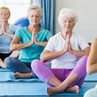 fibromyalgia workshop - women cross legged namaste on yoga mats