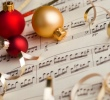 sheet music with holiday ornaments